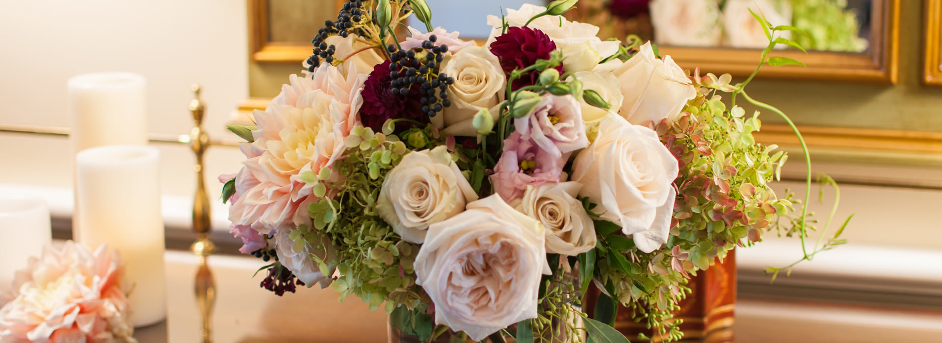 Bouquet of flowers in vase, including pink roses, hydrangeas, carnations, lisanthus and eucalyptus
