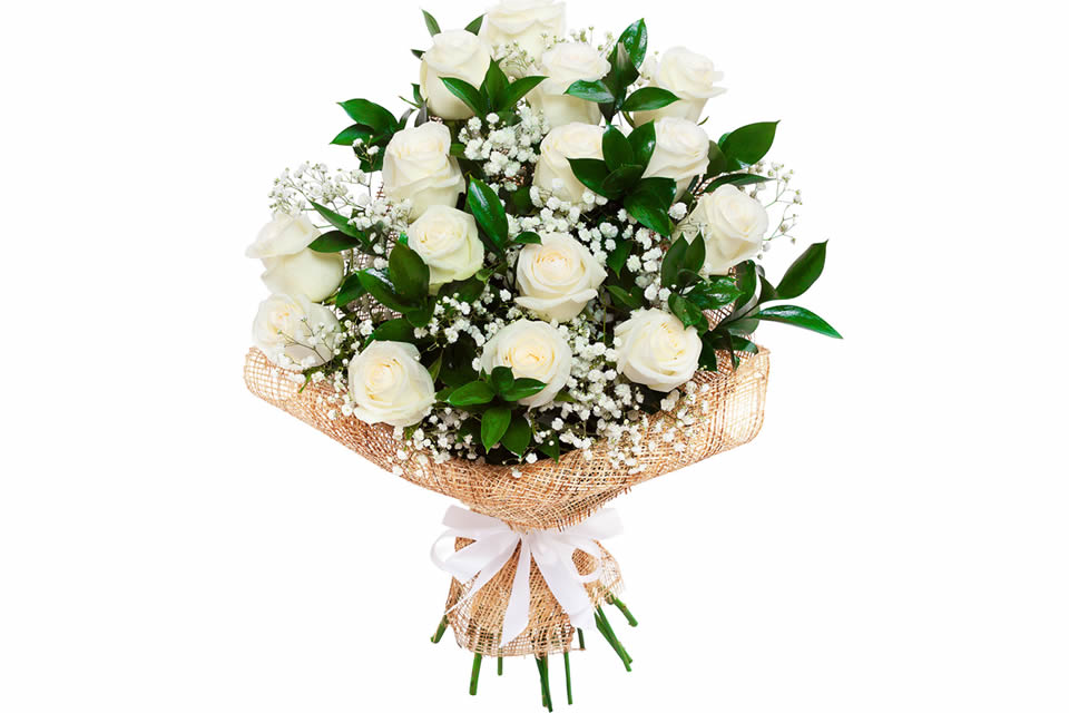 Bouquet of white sympathy roses with gypsophila and ruscus