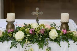 Simple roses decorate church