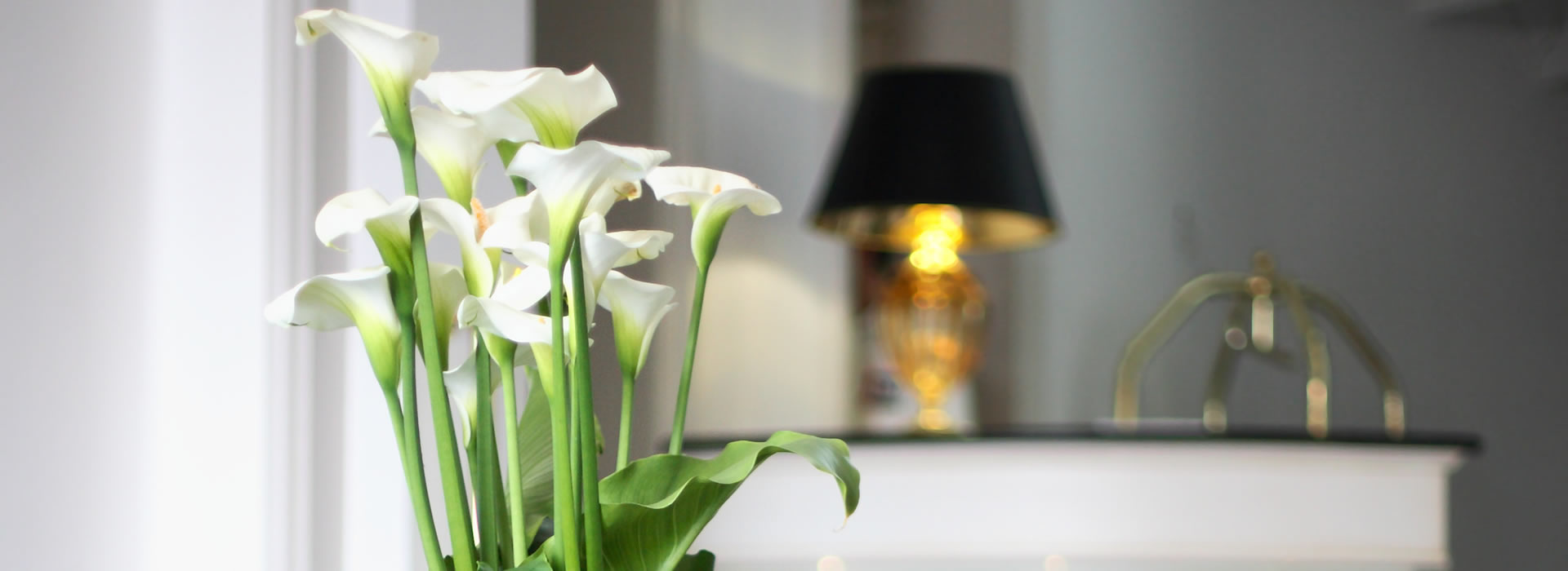 Corporate flowers - calla lilies in a hotel reception