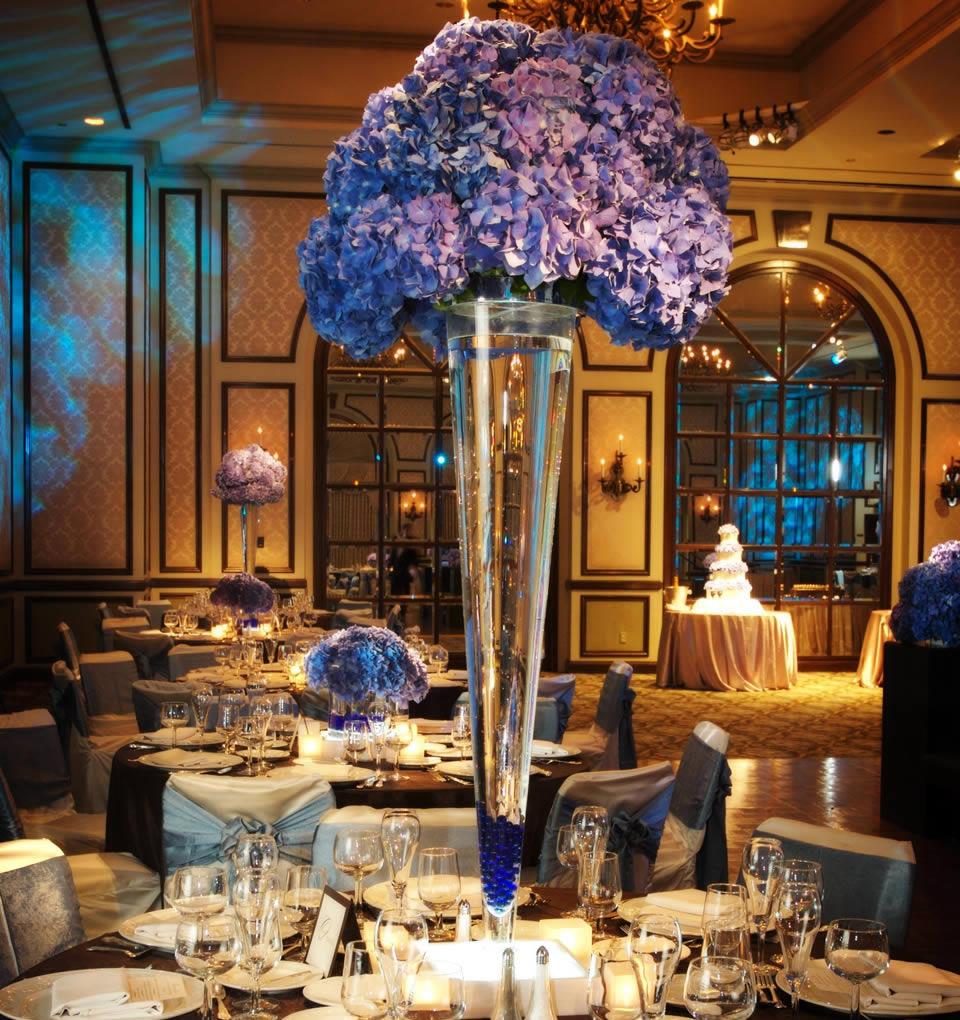 Hydrangeas in a tall vase enhance event