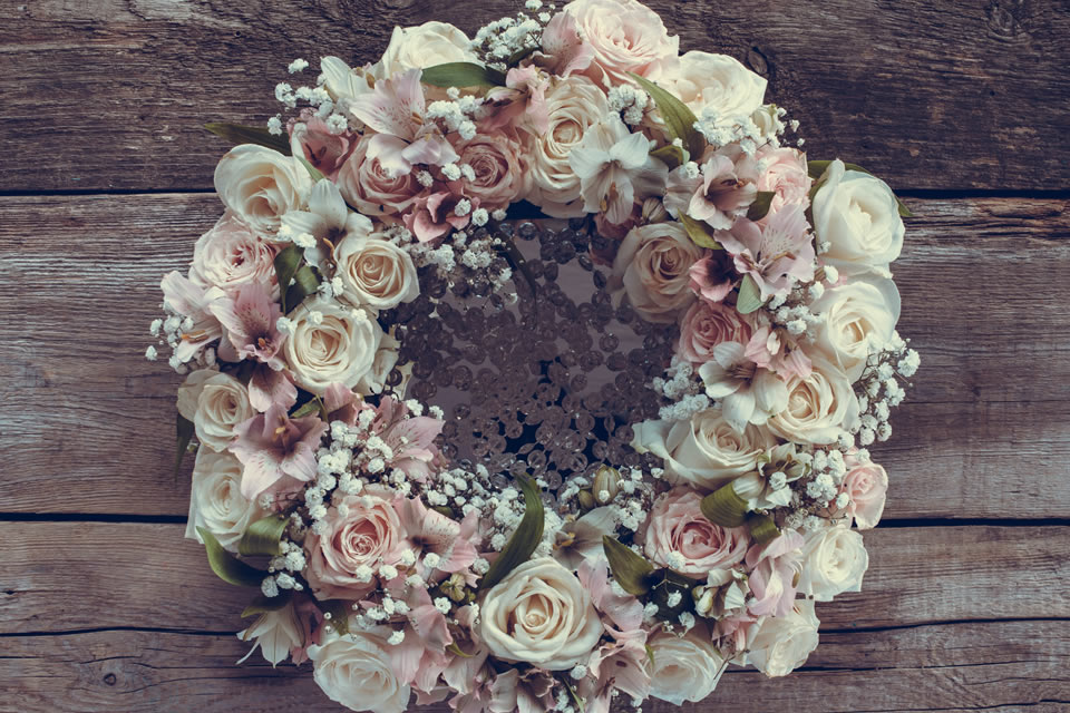 White and pink roses, alstroemeria and gypsophila form an attractive funeral wreath