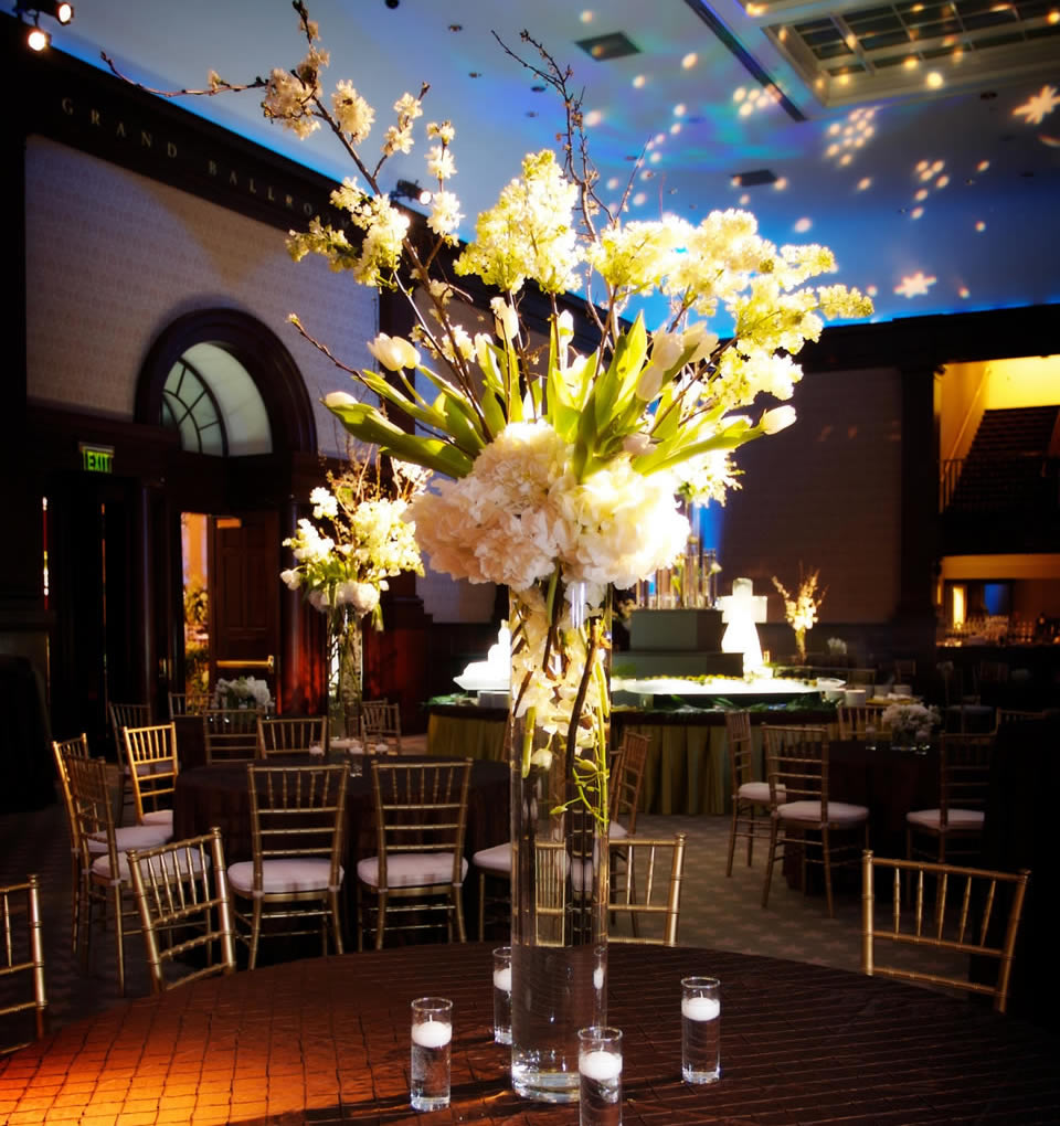 Beautifully-arranged restaurant flowers include tulips, blossom and hydrangea