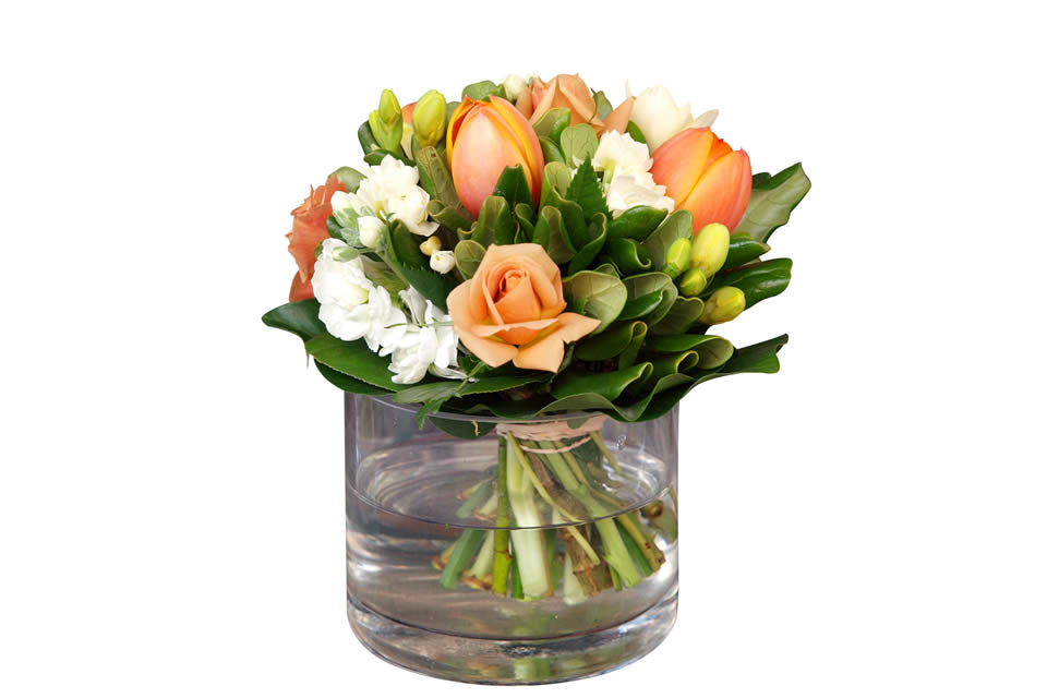 tulips, roses, stock and narcissi buds in a vase