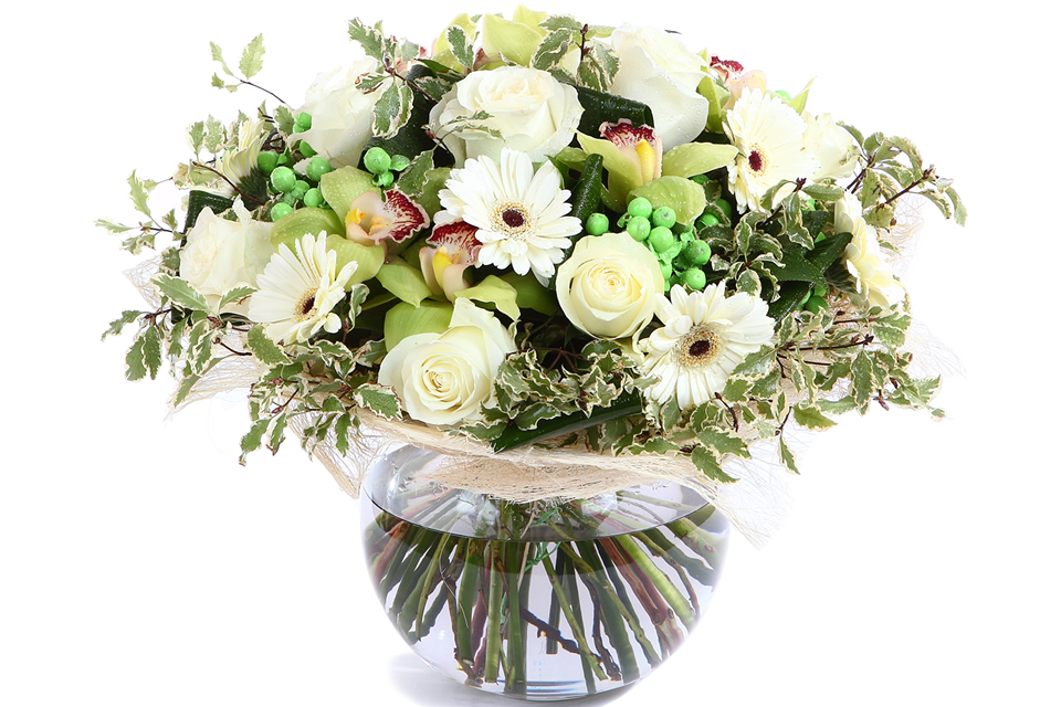 White roses, gerbera daisies and green peas in cellophane vase