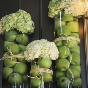 Vases with apples and hydrangeas